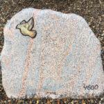 keramikfugl på gravsten
